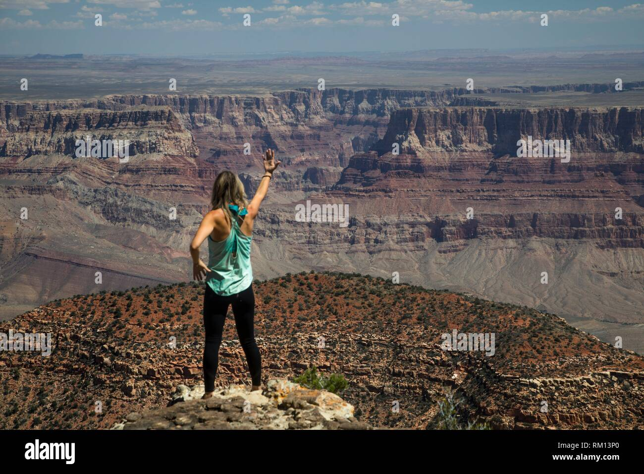 A woman is entranced by the immense beauty of the Grand Canyon at The North Rim, Arizona. - Stock Image