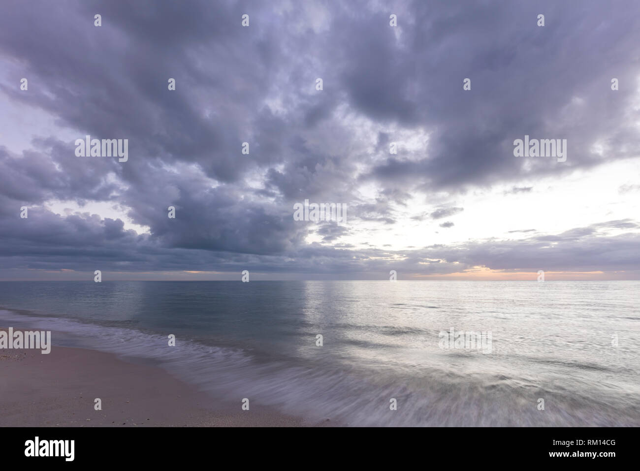 Soft clouds over Florida's Gulf Coast at Naples, USA - Stock Image