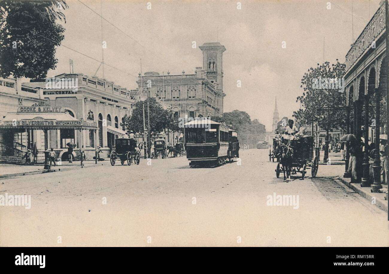 'Old Court House Street from the South. Calcutta', c1910. View of the 'Dead Letter Office', the Telegraph Office in Calcutta, (now Kolkata), Bengal, India. The building, the central sorting office for incoming mail to the city, is Italianate in style with a 120-foot campanile tower. On the left are the premises of Cooke & Kelvey, jewellers, silversmiths and watchmakers, and a tram runs down the centre of the street. Postcard. - Stock Image