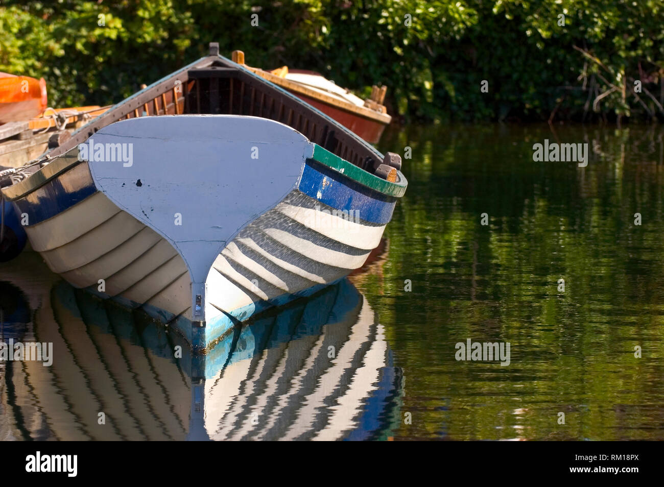 Rowboat in Water - Stock Image