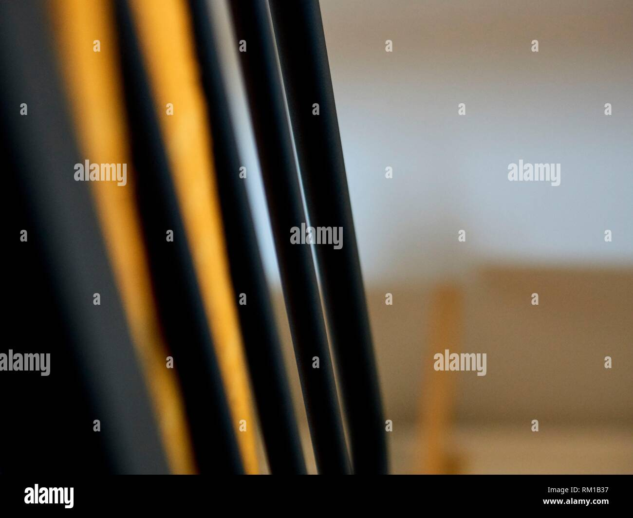 Abstract image, iron bars of a bunk seen from below - Stock Image