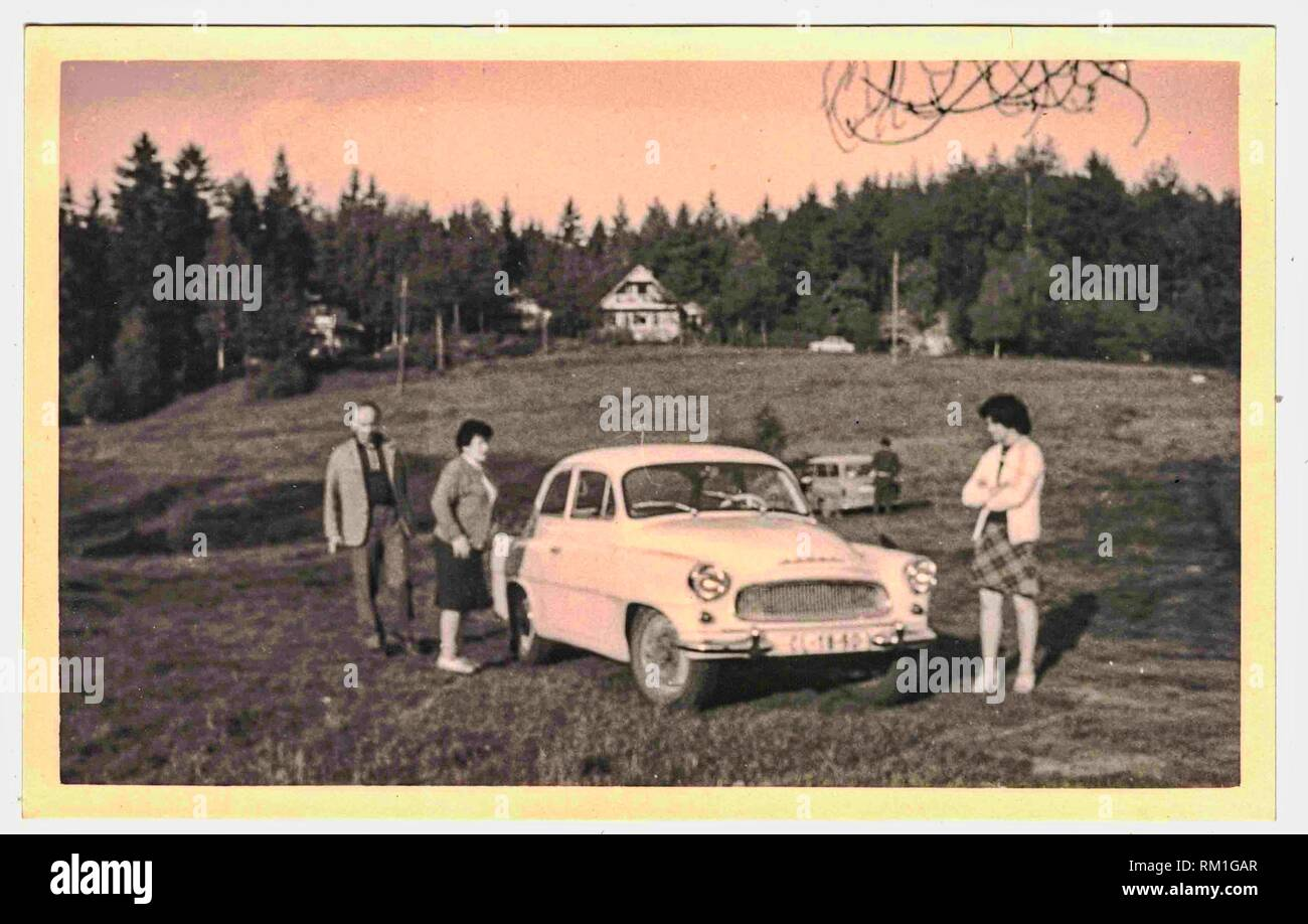THE CZECHOSLOVAK SOCIALIST REPUBLIC - CIRCA 1960s: Retro photo shows familly and retro car (brand Octavia) during weekend trip. Black white photo. - Stock Image