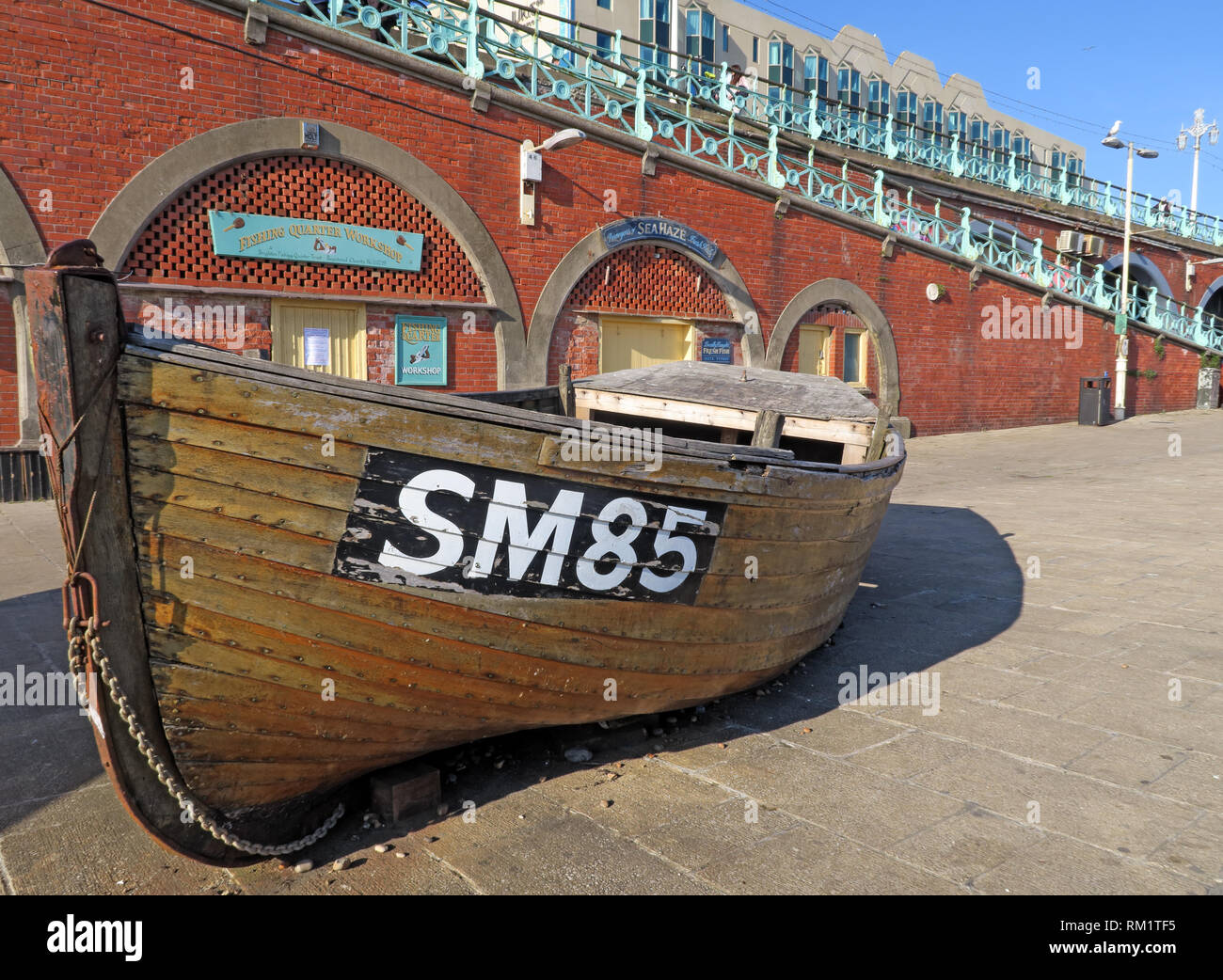 SM85 fishing boat, Brighton beachfront, Kings Road Arches - Stock Image