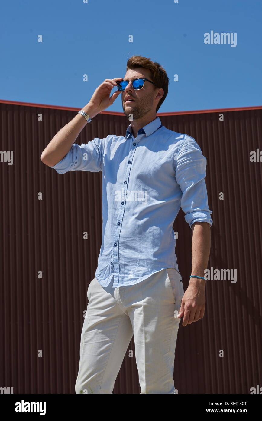 Portrait of Youtuber Axel Sprenger touching sunglasses. In Germany, Bavaria. Stock Photo