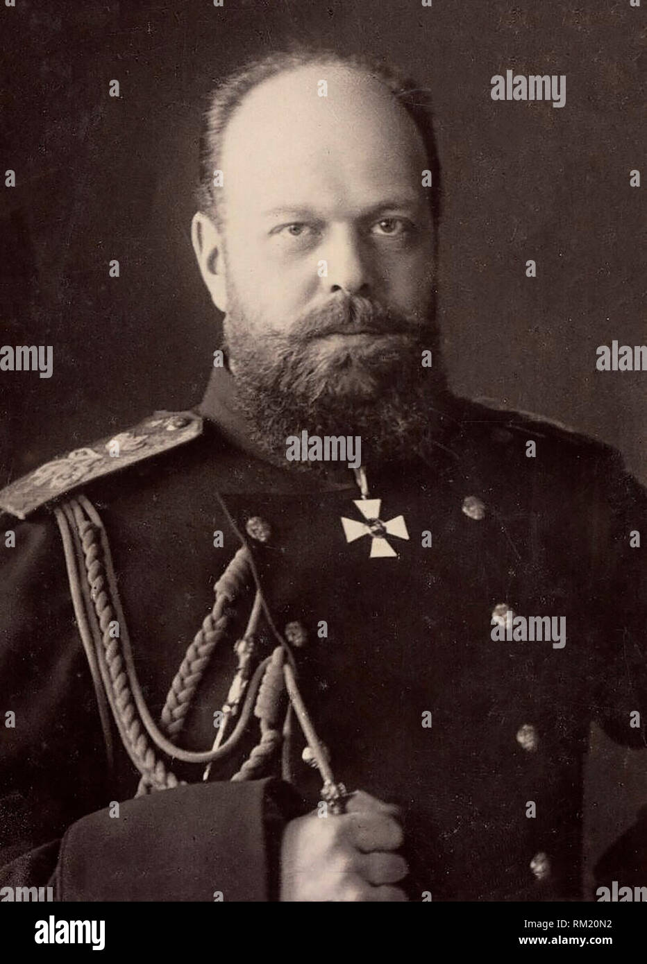 Bust-length photograph of Alexander III, Emperor of Russia. His right arm is raised to his chest and he is wearing military uniform. Alexander III was Emperor of Russia from 1881 until 1894. - Stock Image