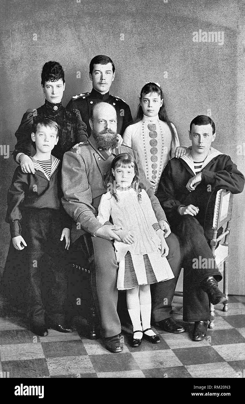 Photograph of Alexander III, Emperor of Russia (1845-94) and his consort Maria Feodorovna, Empress of Russia (1847-1928) with their children Tsesarevich Nicholas (1868-1918), later Nicholas II, Grand Duke George Alexandrovich (1871-99), Grand Duchess Xenia Alexandrovna (1875-1960), Grand Duke Michael Alexandrovich (1878-1918) and Grand Duchess Olga Alexandrovna (1882-1960). Circa 1889 - Stock Image