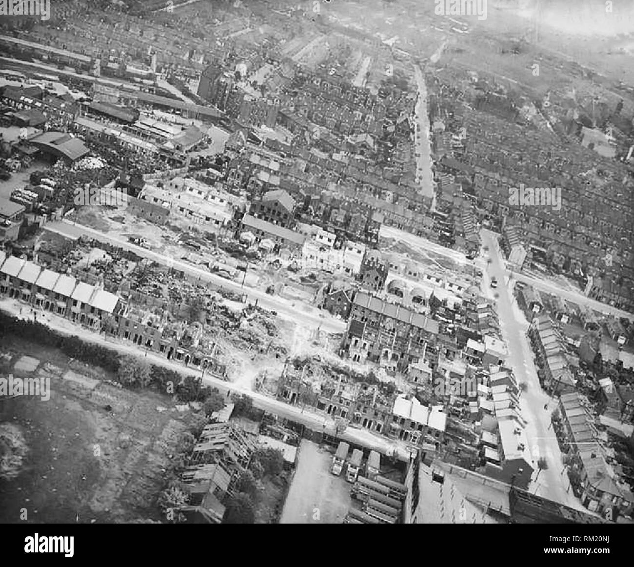 Bomb Damage in London, England, April 1945 Aerial view from the west of the damage resulting from a V2 rocket missile which exploded in the area of Boleyn and Priory Roads, Upton Park, East Ham, London E6, England at 10.30 am on 28 January 1945. Sixteen people were killed, twenty-seven seriously injured and sixty-nine slightly wounded. 5 houses were completely demolished, 16 partly demolished and a further 59 were seriously damaged. - Stock Image