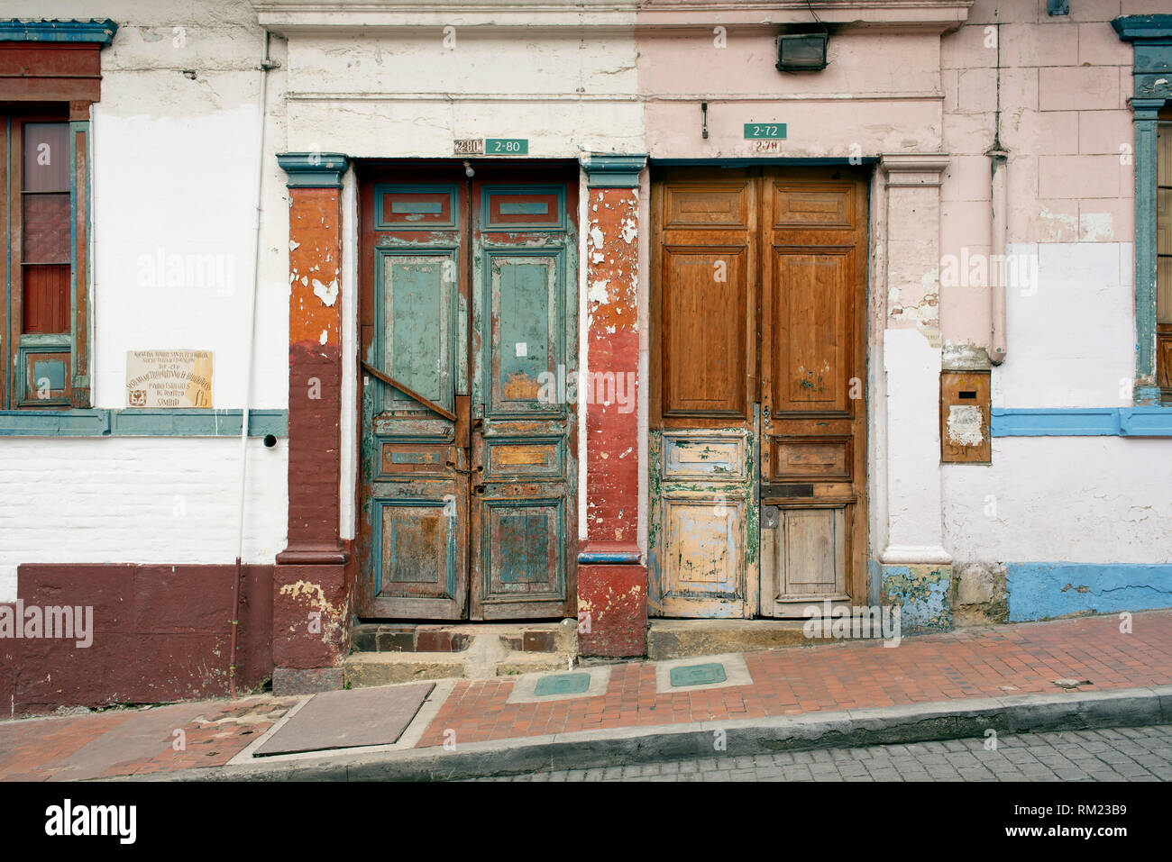 Colonial architecture with worn out doors in La Candelaria, downtown Bogota, Colombia. Sep 2018 - Stock Image