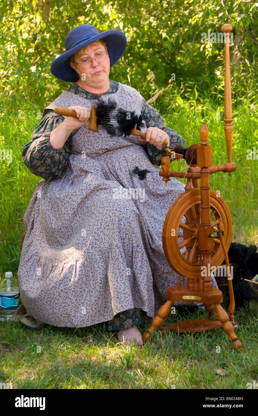 Reenactor spinning wool, Travelers Rest State Park, Lewis and Clark National Historic Trail, Montana. - Stock Image