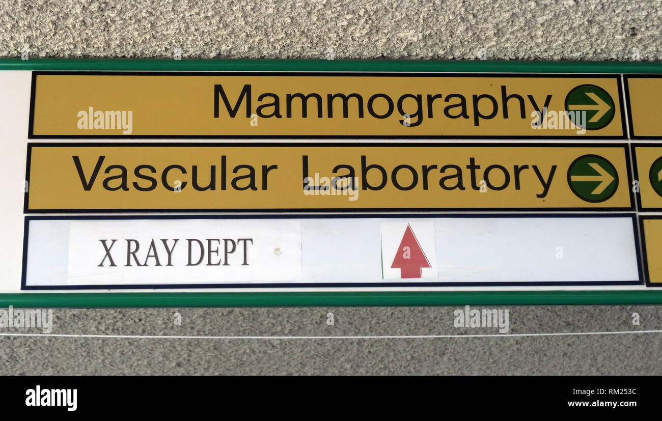 Hospital signs to Mammography , Vascular Laboratory, X Ray Dept in a NHS Hospital Trust, Halton, Cheshire, North West England, Cheshire, UK - Stock Image