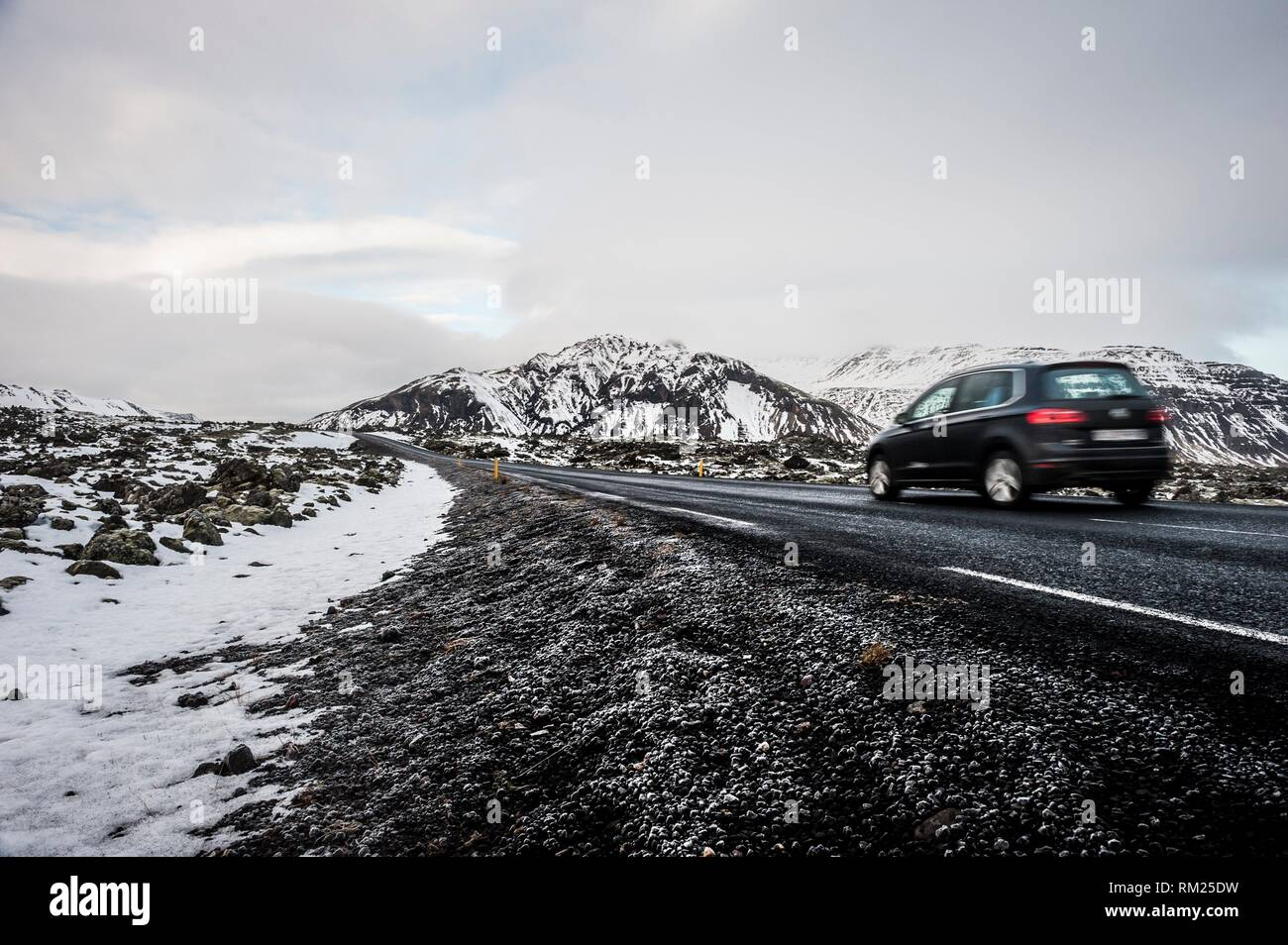 Car along route 54 crossing a lava field in Snæfellsnes peninsula (region of Vesturland, Iceland). - Stock Image