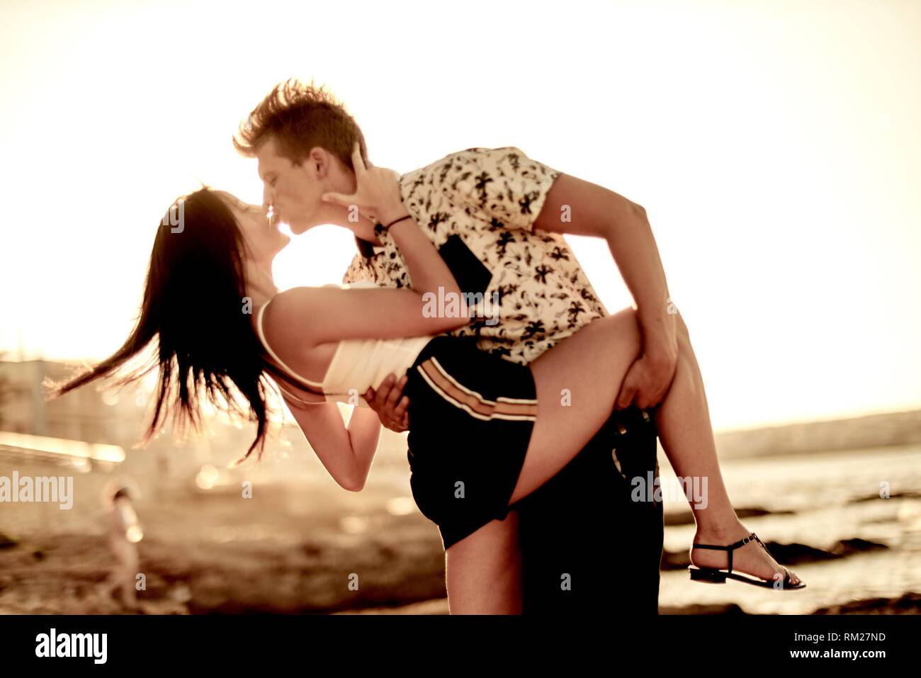 passionate lovers kissing, love, dancing, seaside, holiday. Chersonissos, Crete, Greece. - Stock Image