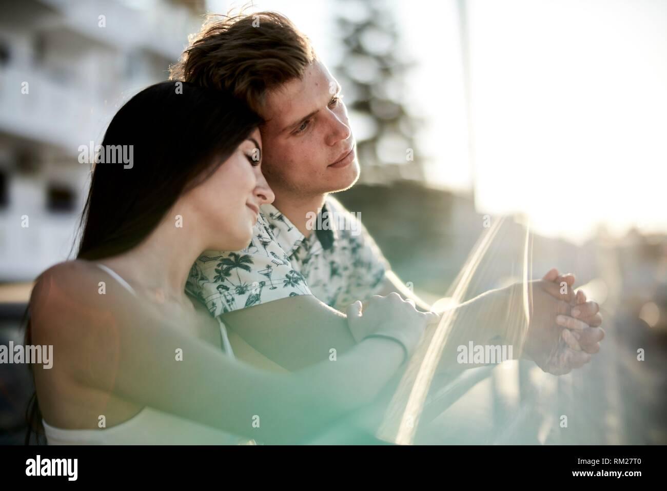 Couple, bonding, love, relationship, reliable, togetherness. Chersonissos, Crete, Greece. - Stock Image