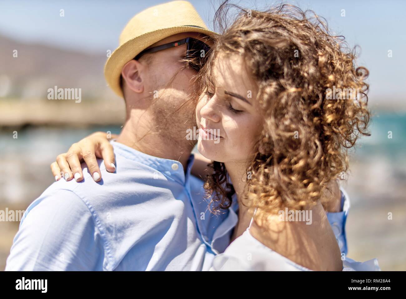 woman enjoying seduction of man, at beach, holidays, summer - Stock Image