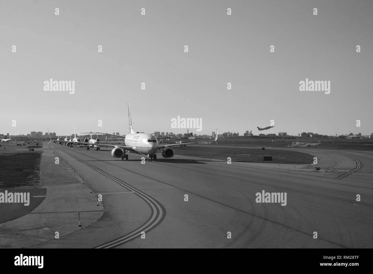 NEW YORK - APRIL 05, 2016: planes line up at LaGuardia Airport. LaGuardia Airport is an international airport located in the northern part of Queens,  - Stock Image