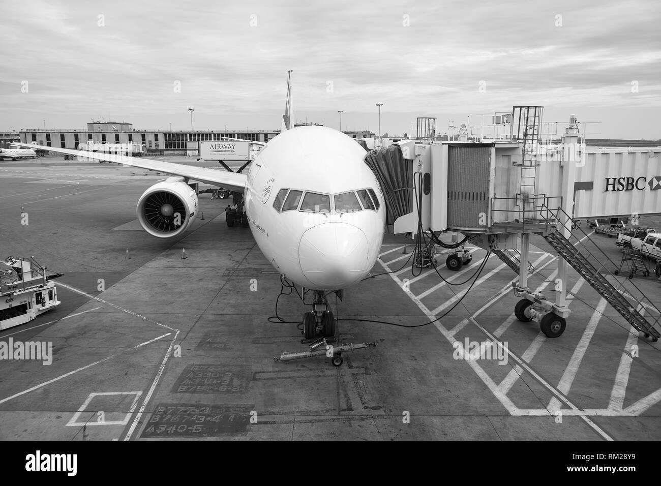 NEW YORK - APRIL 06, 2016: passenger jet airplane docked at JFK Airport. John F. Kennedy International Airport is a major international airport locate - Stock Image