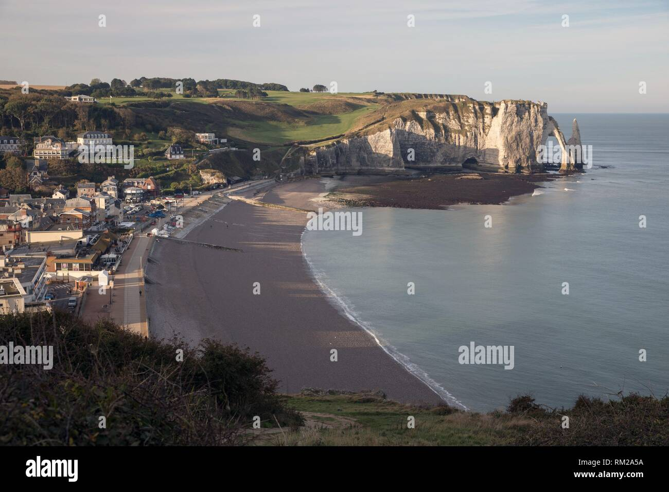 Etretat with Porte d´Aval (Agal gate), Aiguille (needle) and cliffs in background. Normandy, France - Stock Image