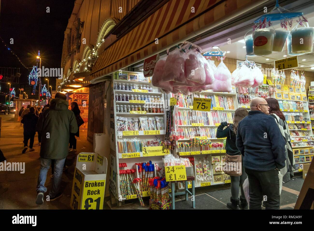 Blackpool rock and candy store with bags of candy floss, sugar lollies and canes by the famous illuminations of Blackpool´s Golden Mile, Blackpool, - Stock Image