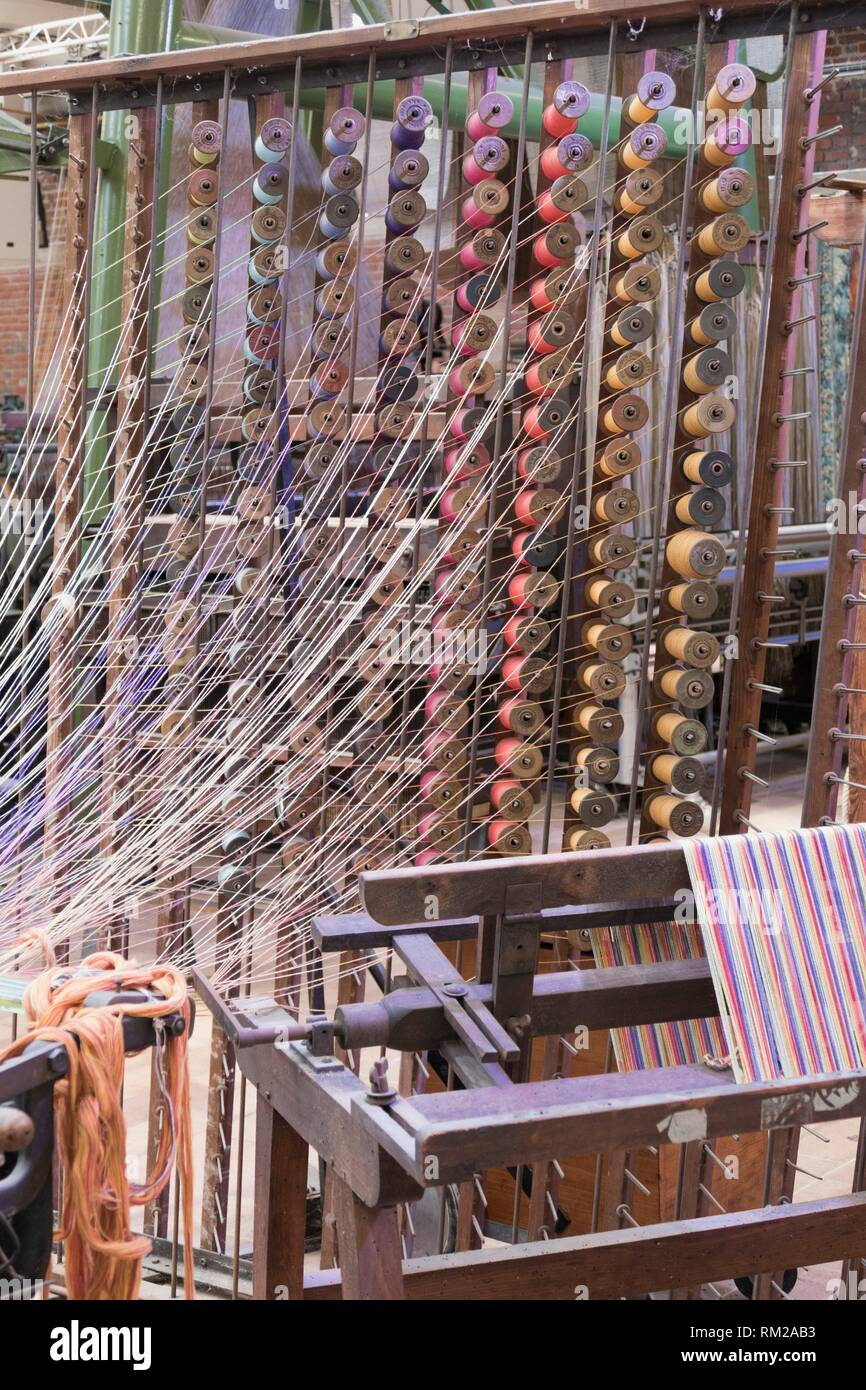 Woosh of filmy threads from columns of stacked, brightly
