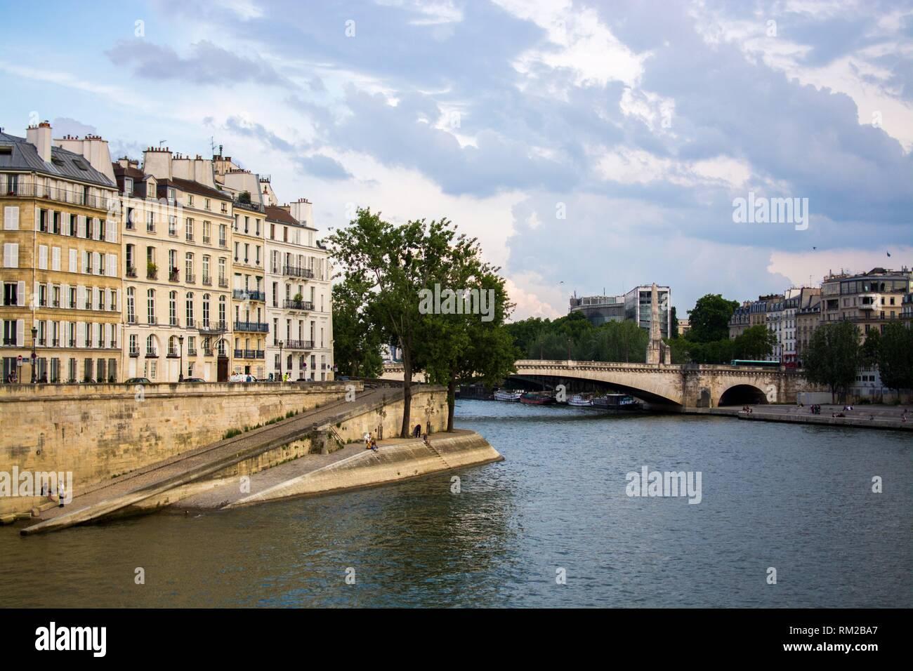 View of the Seine river and Pont de la Tournelle bridge in a sunny day. Paris, France. - Stock Image