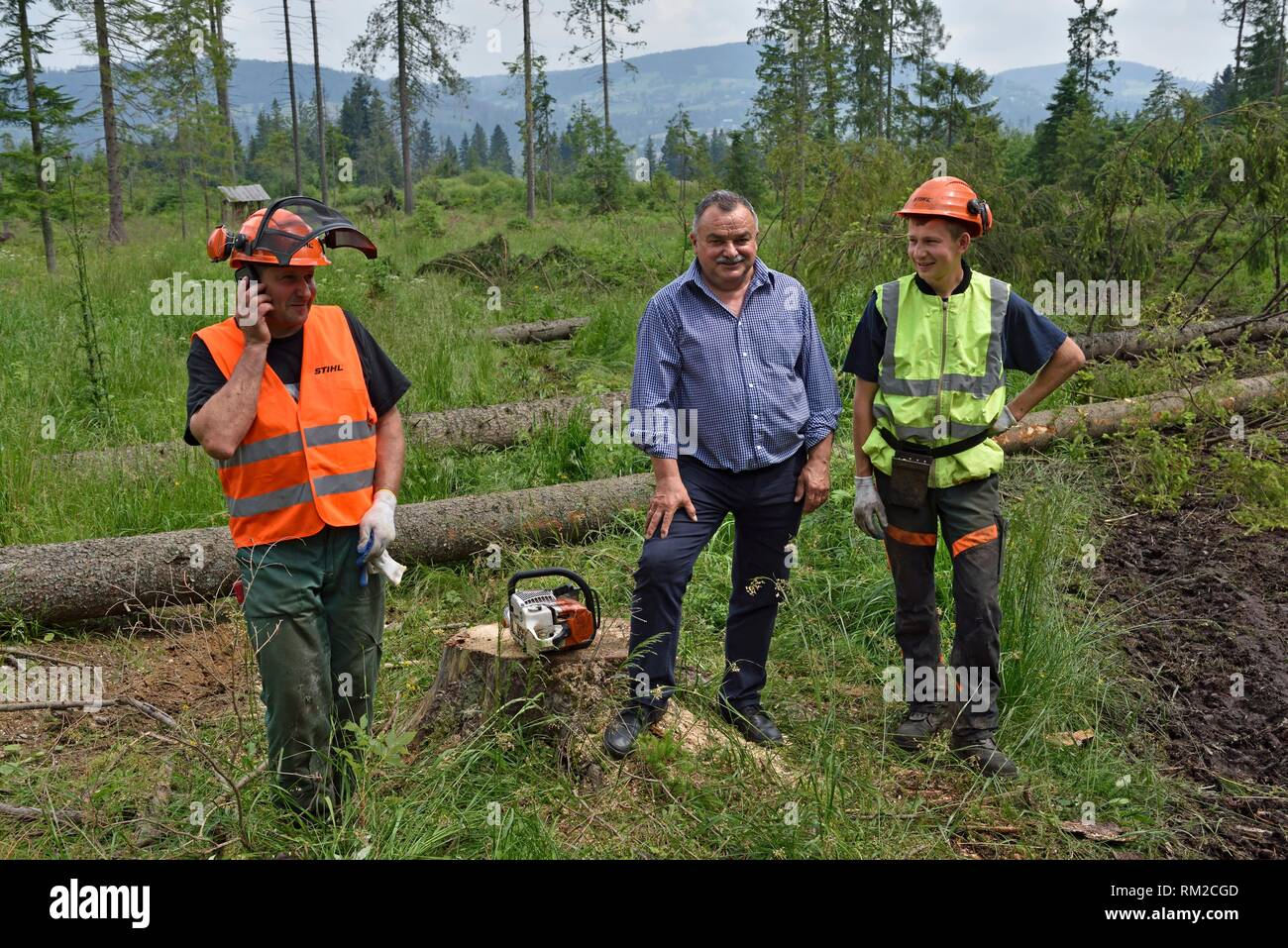 lumberjack, father and son, posing with Jan Picura (at the center) president of an association of 7 villages, Chocholowska Valley, near Witow, - Stock Image