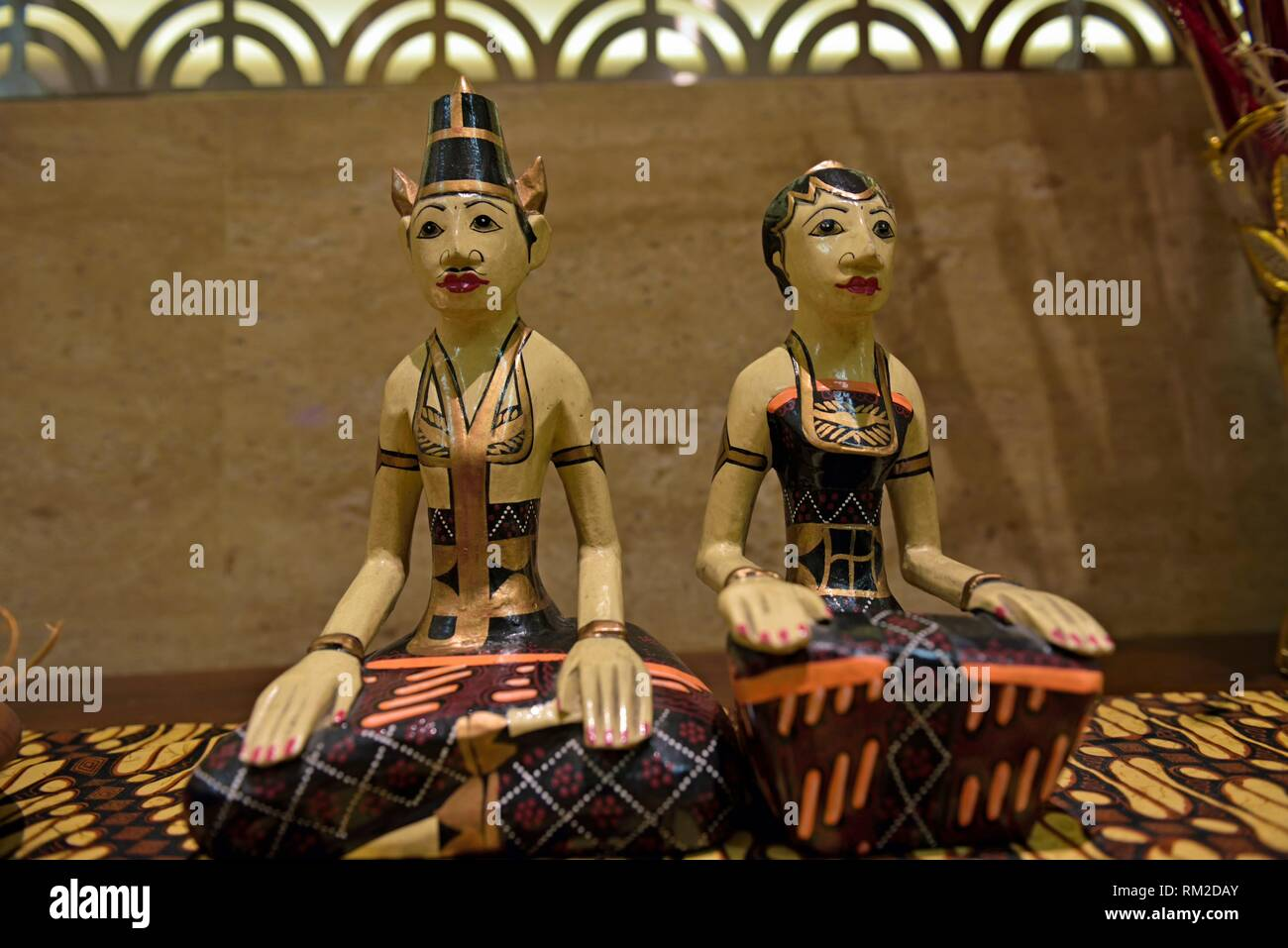 ´´Loro Blonyo´´, painted wooden couple of statue depicting the goddess of fertility Dewi Sri and his husband, is found easily in Javanese home, hotel - Stock Image