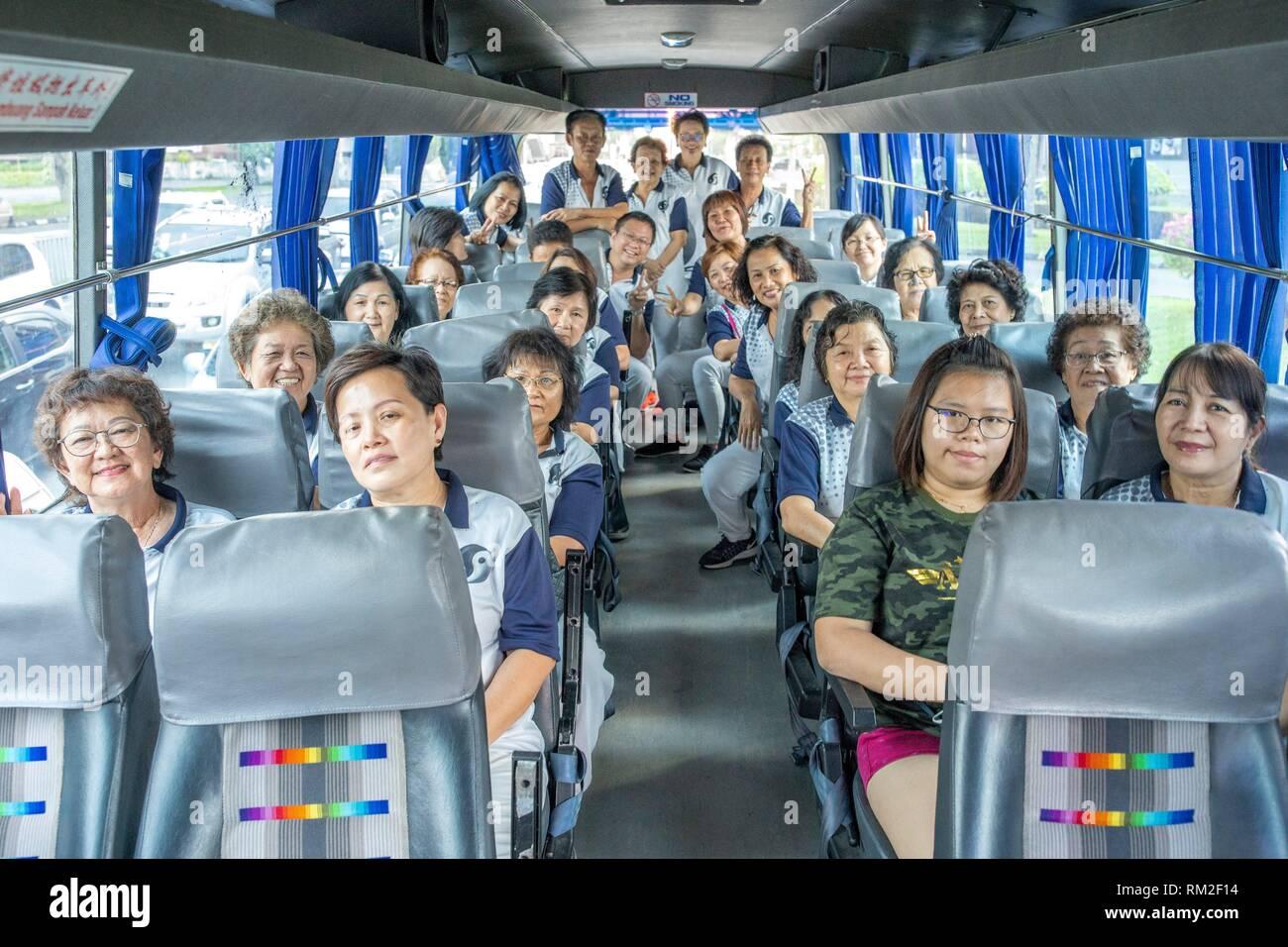 Taichi participants taking a bus to Hockey Stadium. - Stock Image