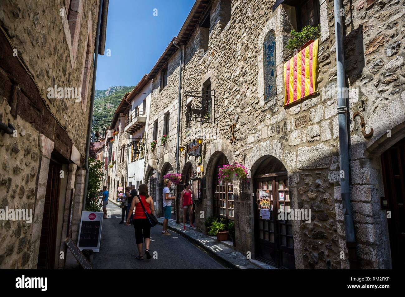 Flag of Roussillon in a medieval street, Villefranche-de-Conflent (department of Pyrénées-Orientales, region of Occitanie, France). - Stock Image