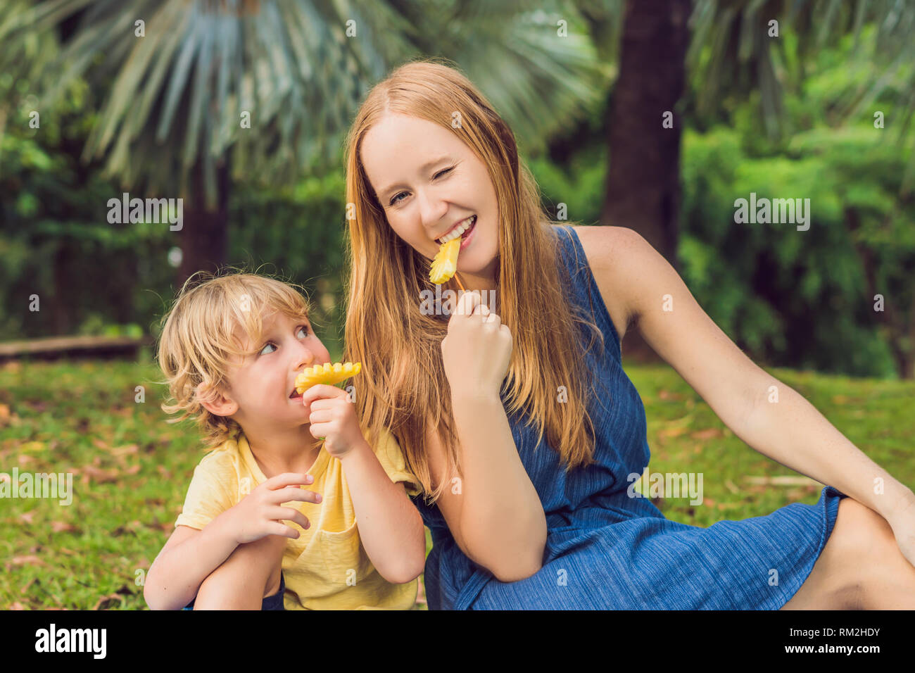 Mom and son riding melons