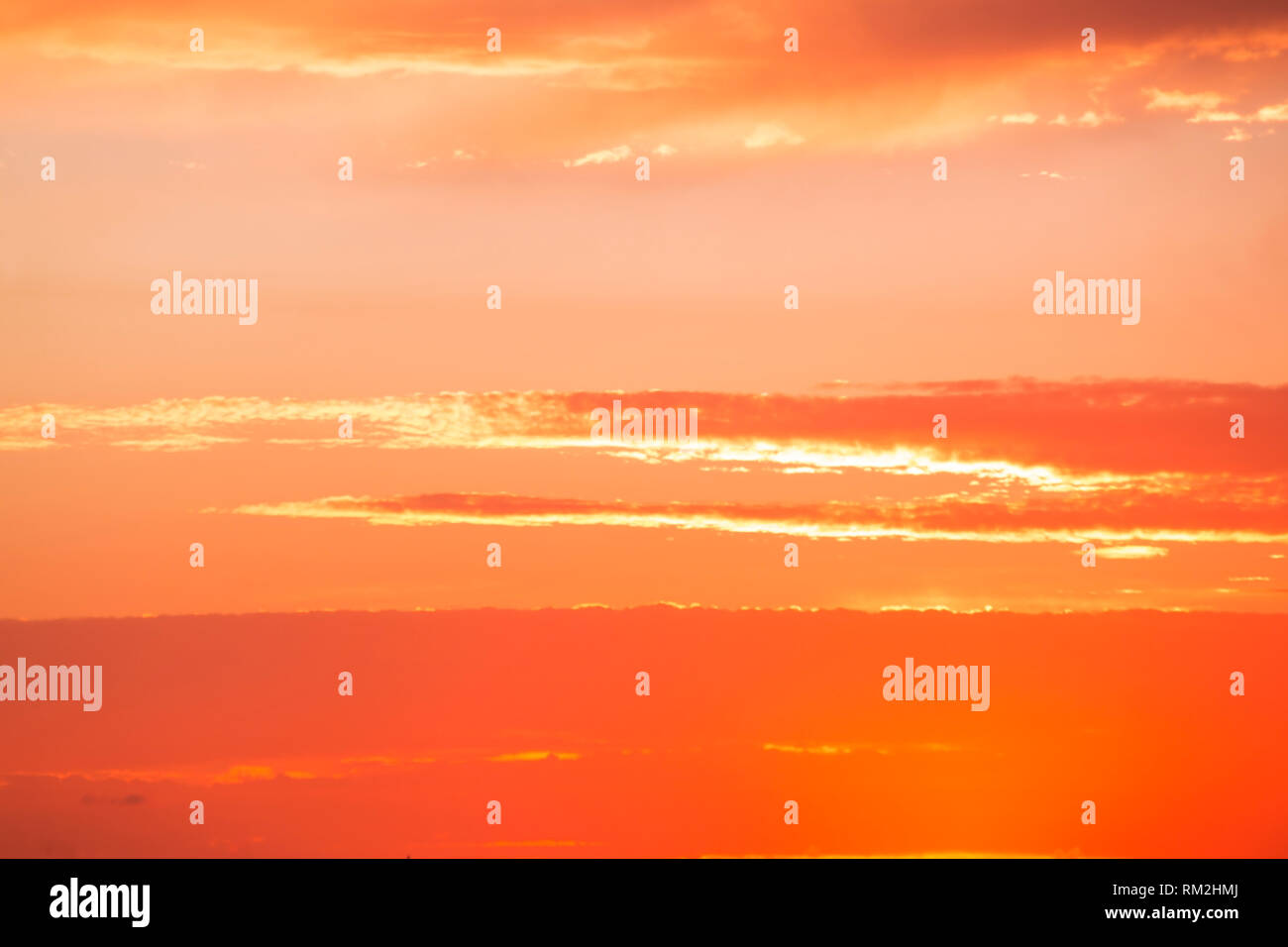 Bright orange sky in sunset - Stock Image