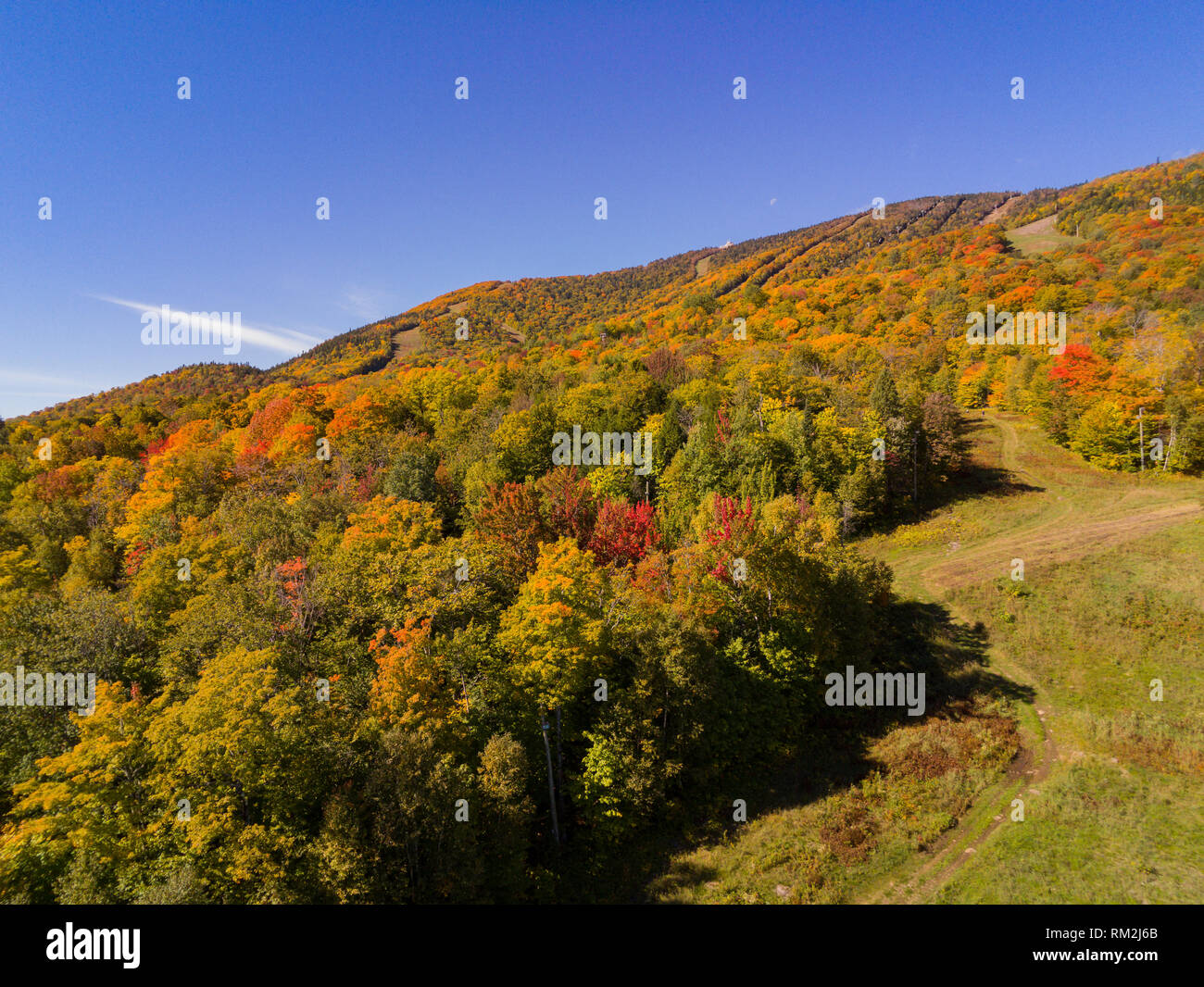 Aerial view of some rural fall color landscape over Mont Orford at Quebec, Canada - Stock Image