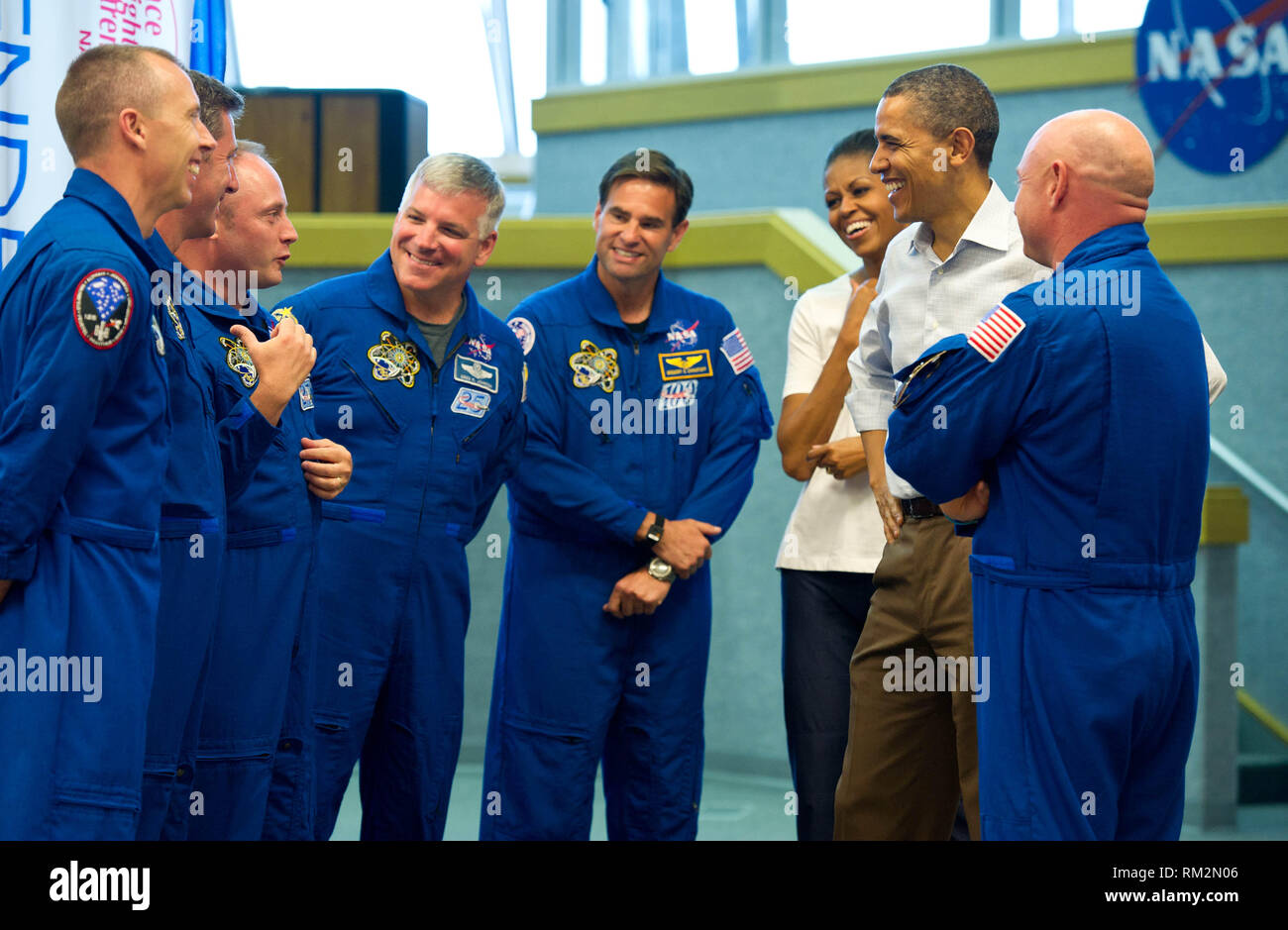United States President Barack Obama and First Lady Michelle Obama meet with STS-134 space shuttle Endeavor commander Mark Kelly, right, and shuttle astronauts, from left, Andrew Feustel, European Space Agency's Roberto Vittori, Michael Fincke, Gregory H. Johnson, and Greg Chamitoff, after their launch was scrubbed, Friday, April 29, 2011, at Kennedy Space Center in Cape Canaveral, Florida..Mandatory Credit: Bill Ingalls / NASA via CNP /MediaPunch - Stock Image