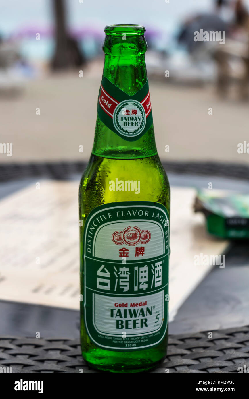 Hengchun, Taiwan - Feb 2019: Chilled bottle of Taiwan Beer at Baisha Beach - Stock Image