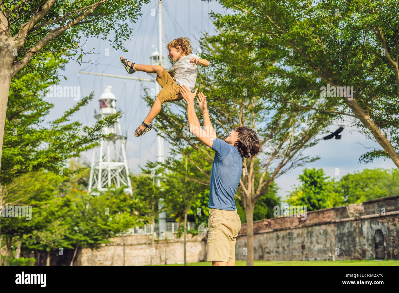 Dad and son on background of Fort Cornwallis in Georgetown, Penang, is a star fort built by the British East India Company in the late 18th century - Stock Image