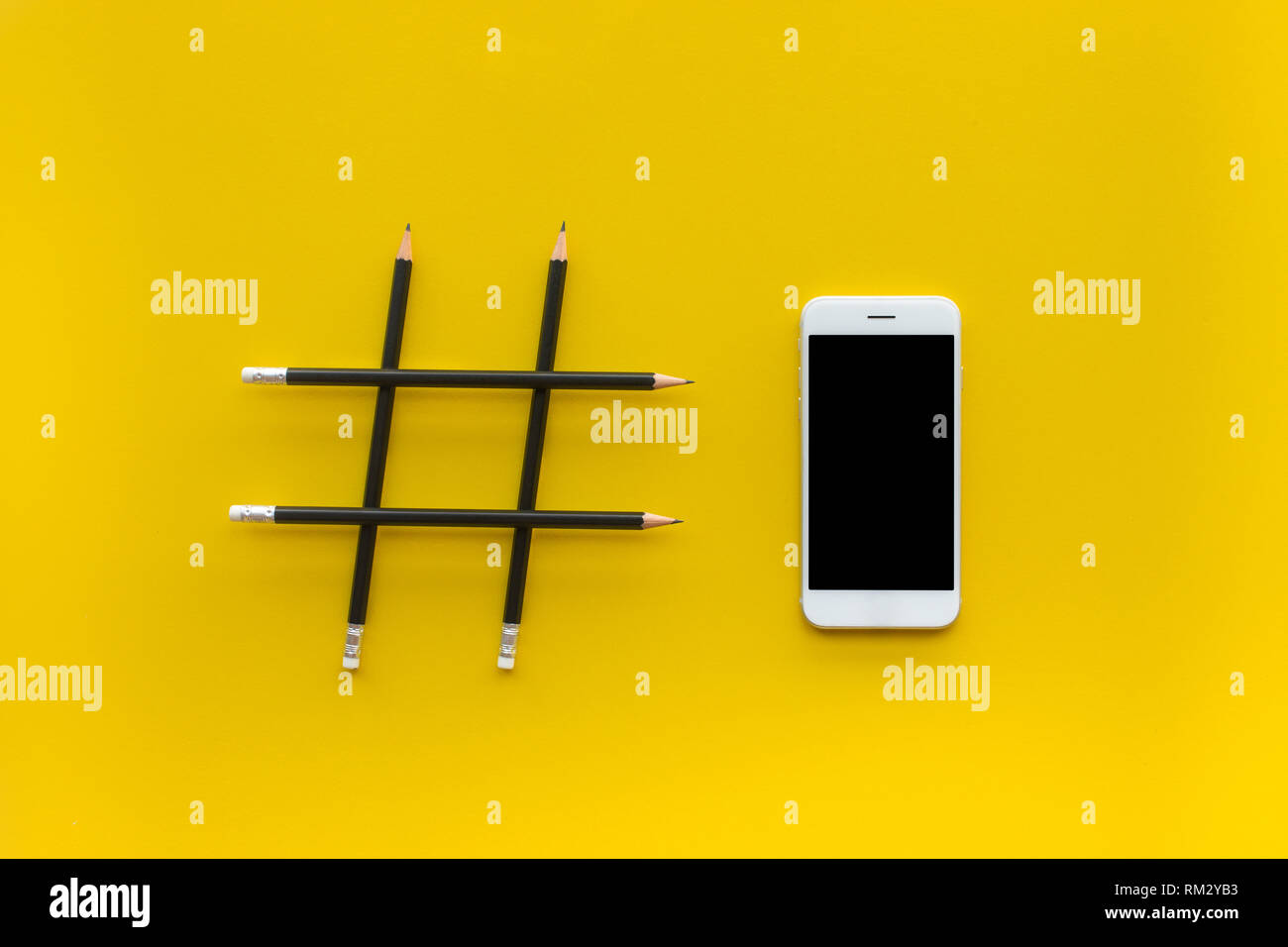 Social media and creativity concepts with Hashtag sign made of pencil and smartphone.digital marketing images.power of conversation. - Stock Image