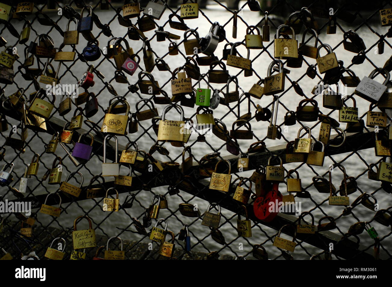 AJAXNETPHOTO. JUNE, 2012. PARIS, FRANCE. - LOVE LOCKED BRIDGE - LOVE LOCKS ON PONT DES ARTES. BY 2015 THE WEIGHT OF THE LOCKS - ABOUT A MILLION - WAS ESTIMATED AT 45 TONNES, DAMAGING SECTIONS OF THE BRIDGE. THE CITY REMOVED LOCKS AND REPLACED THEM WITH PANELS OF STREET ART.PHOTO:JONATHAN EASTLAND/AJAX REF:D121506_2833 - Stock Image