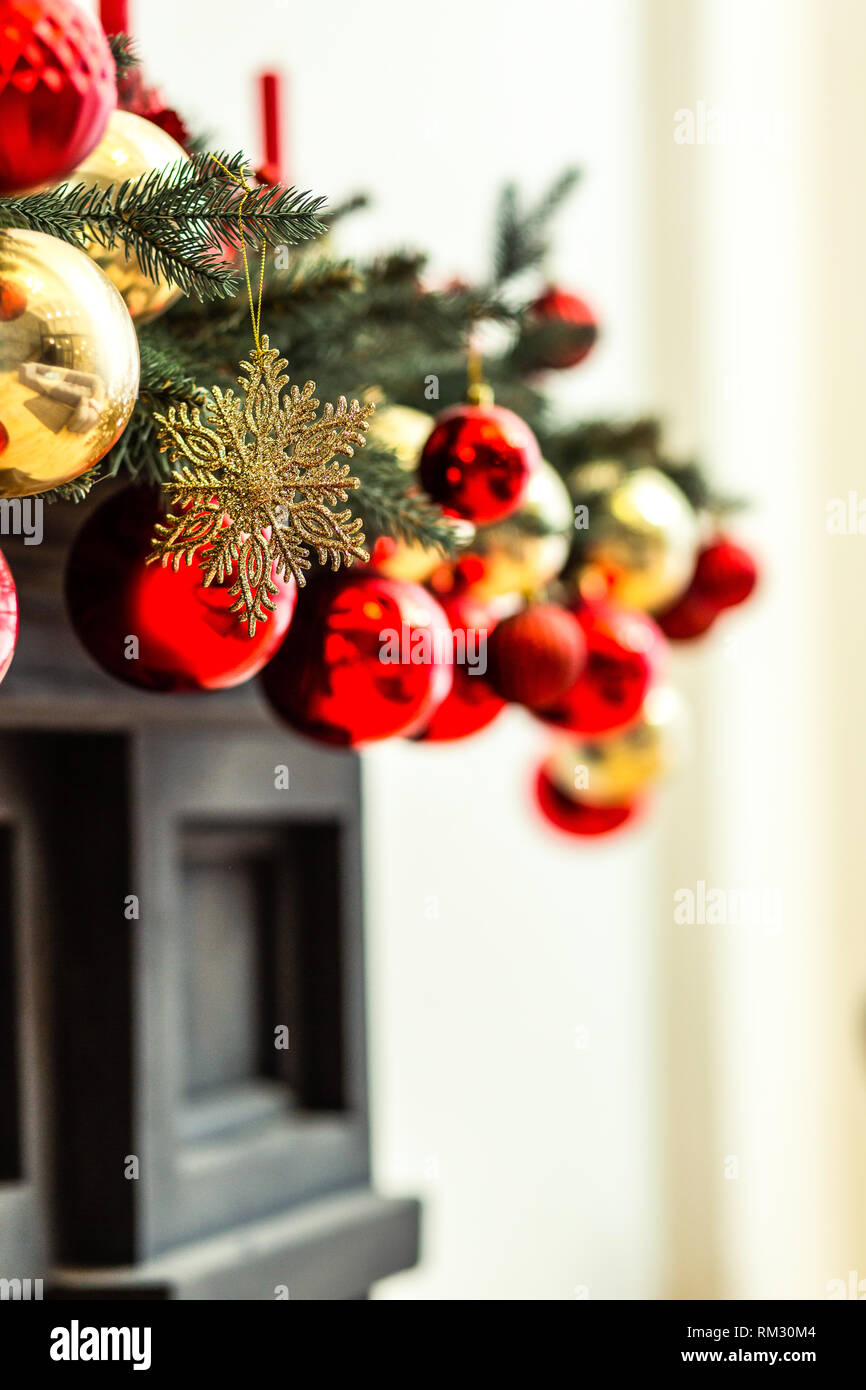 Beautiful red and golden christmas ornaments looking wonderful on the christmas tree - Stock Image
