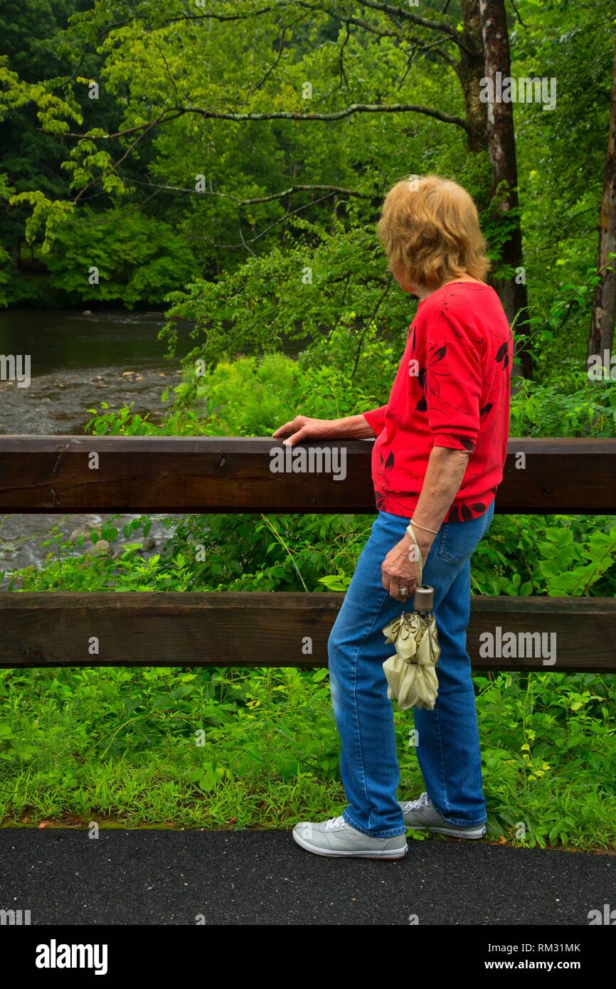 Senior walker on trail, Farmington River Trail, Burlington, Connecticut. - Stock Image