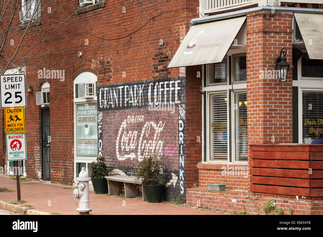 Brick wall at Grant Park Coffeehouse on Cherokee Avenue in Atlanta, Georgia, USA. - Stock Image