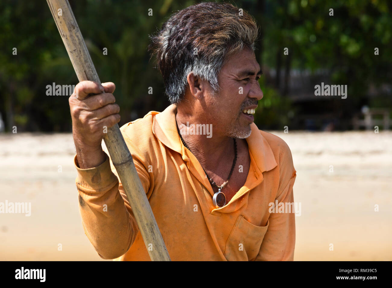 A MOKEN MAN on his traditional boat to KHO RA ISLAND in the Andaman Sea - THAILAND - Stock Image