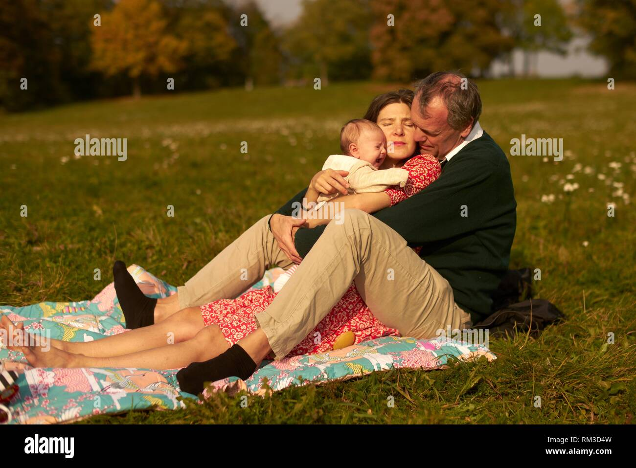Couple baby family age difference outdoors in park generations grandfather at neuhofener berg munich germany