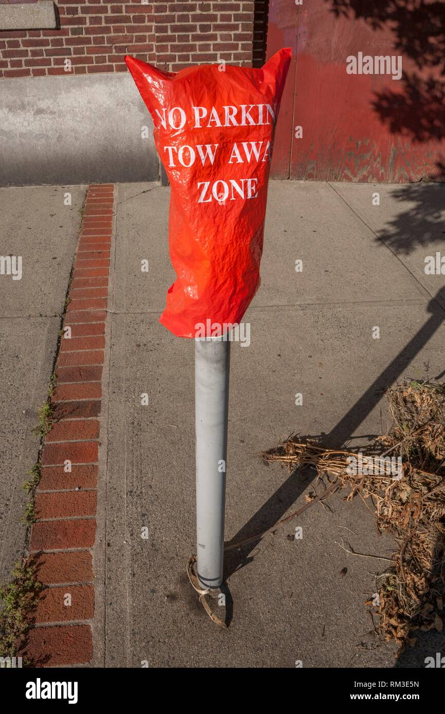 Sign on a parking meter reading, ''No Parking - Tow Away Zone''. - Stock Image