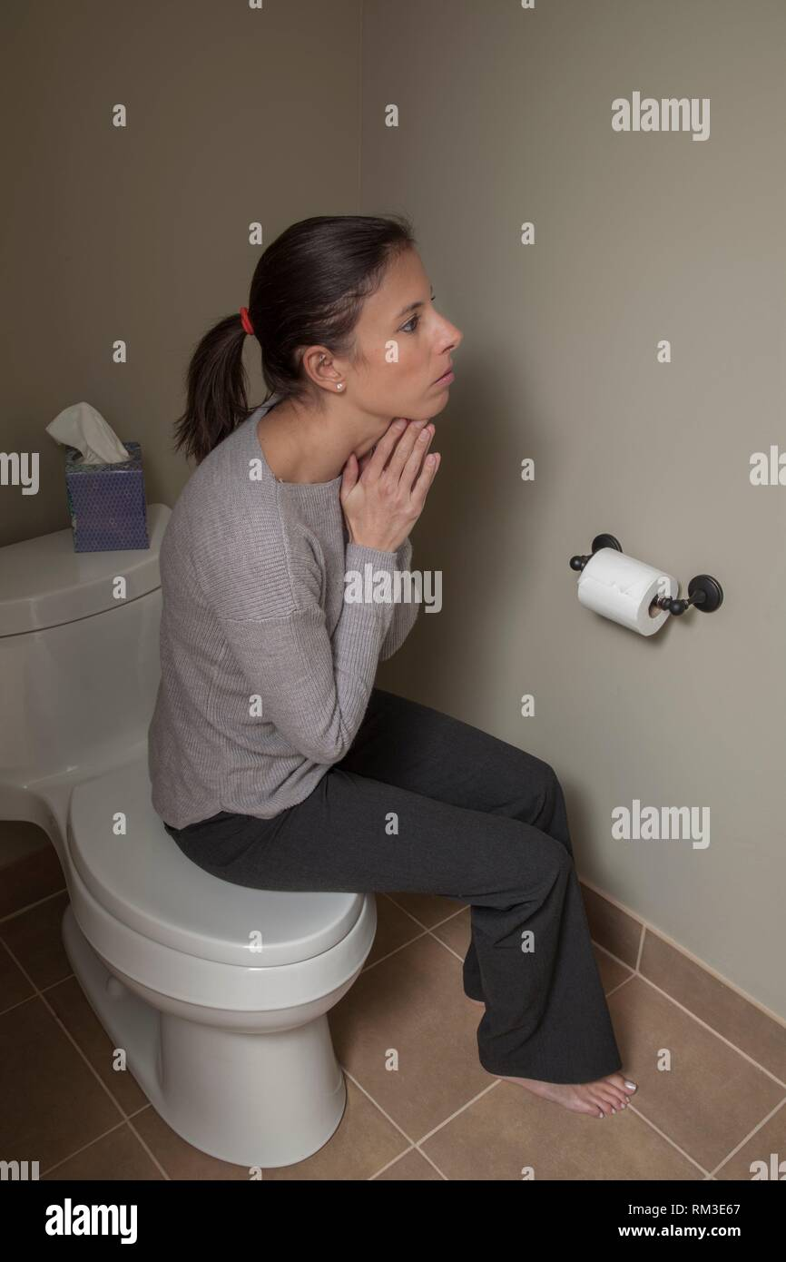 Brilliant Young Woman Sitting On Her Closed Toilet Lid Stock Photo Theyellowbook Wood Chair Design Ideas Theyellowbookinfo