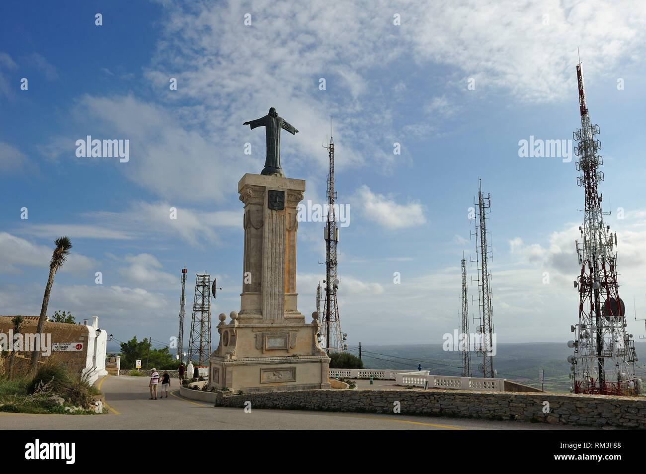 statue of Christ and telecommunications towers at the top of Monte Toro, the tallest hill of Menorca, Balearic Islands, Spain, Europe. - Stock Image