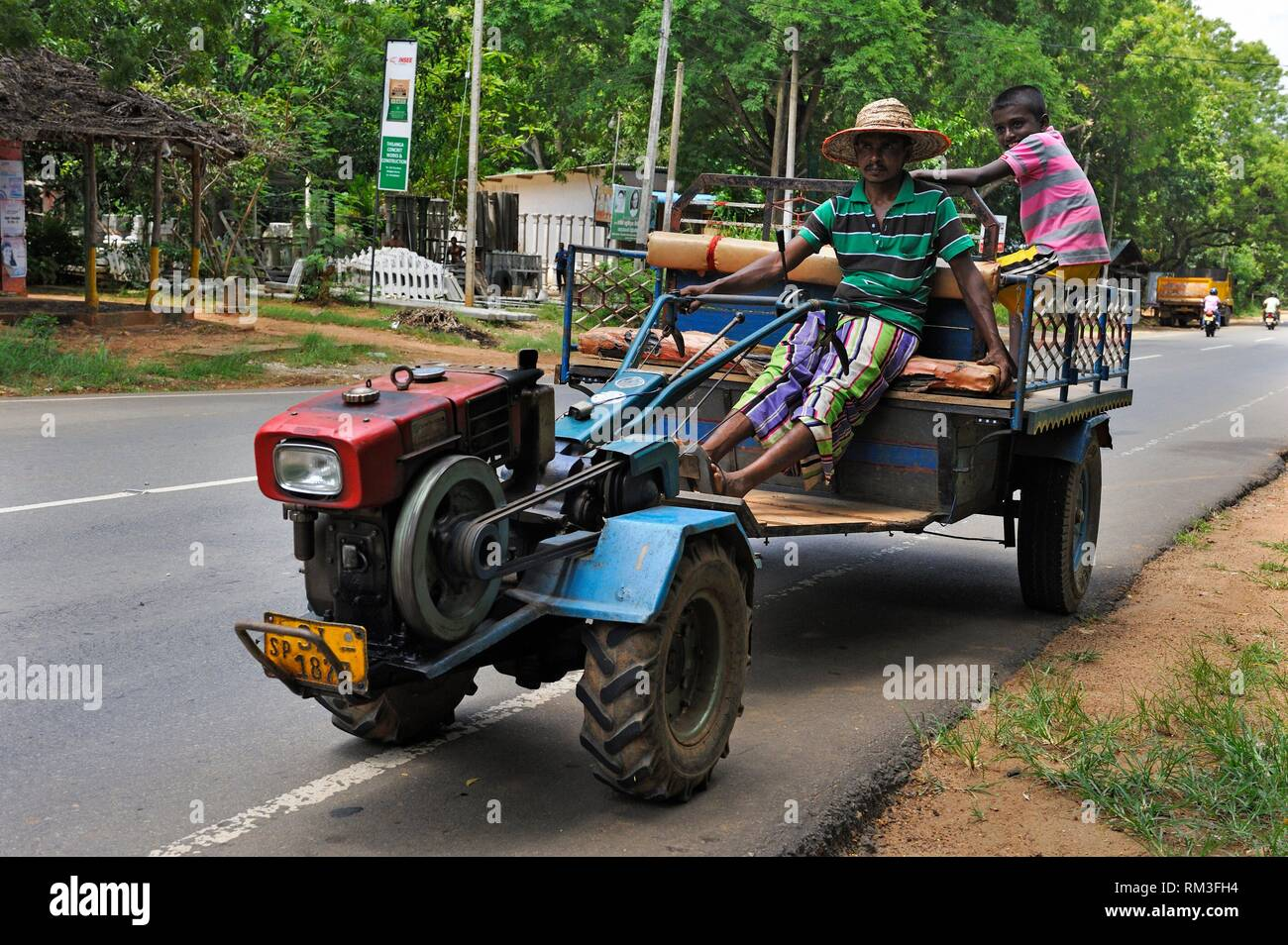 cart towed with motorized cultivator, Sri Lanka, Indian subcontinent, South Asia. - Stock Image
