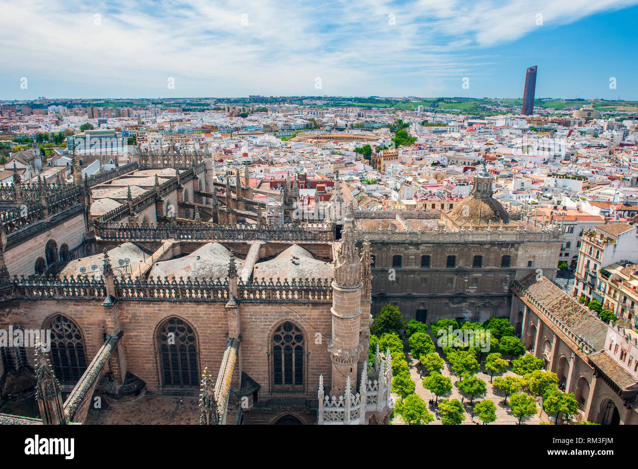 Looking down on Seville Cathedral from the church's 11th century Giralda. Built on the site of the Moorish 12th century Almohad mosque, it is one of t Stock Photo