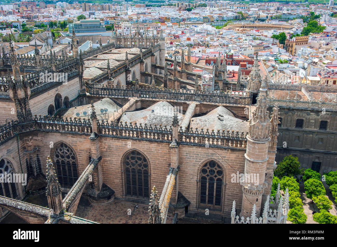 Looking down on Seville Cathedral from the church's Giralda. Built on the site of the Moorish 12th century Almohad mosque, it is one of the largest Ch Stock Photo