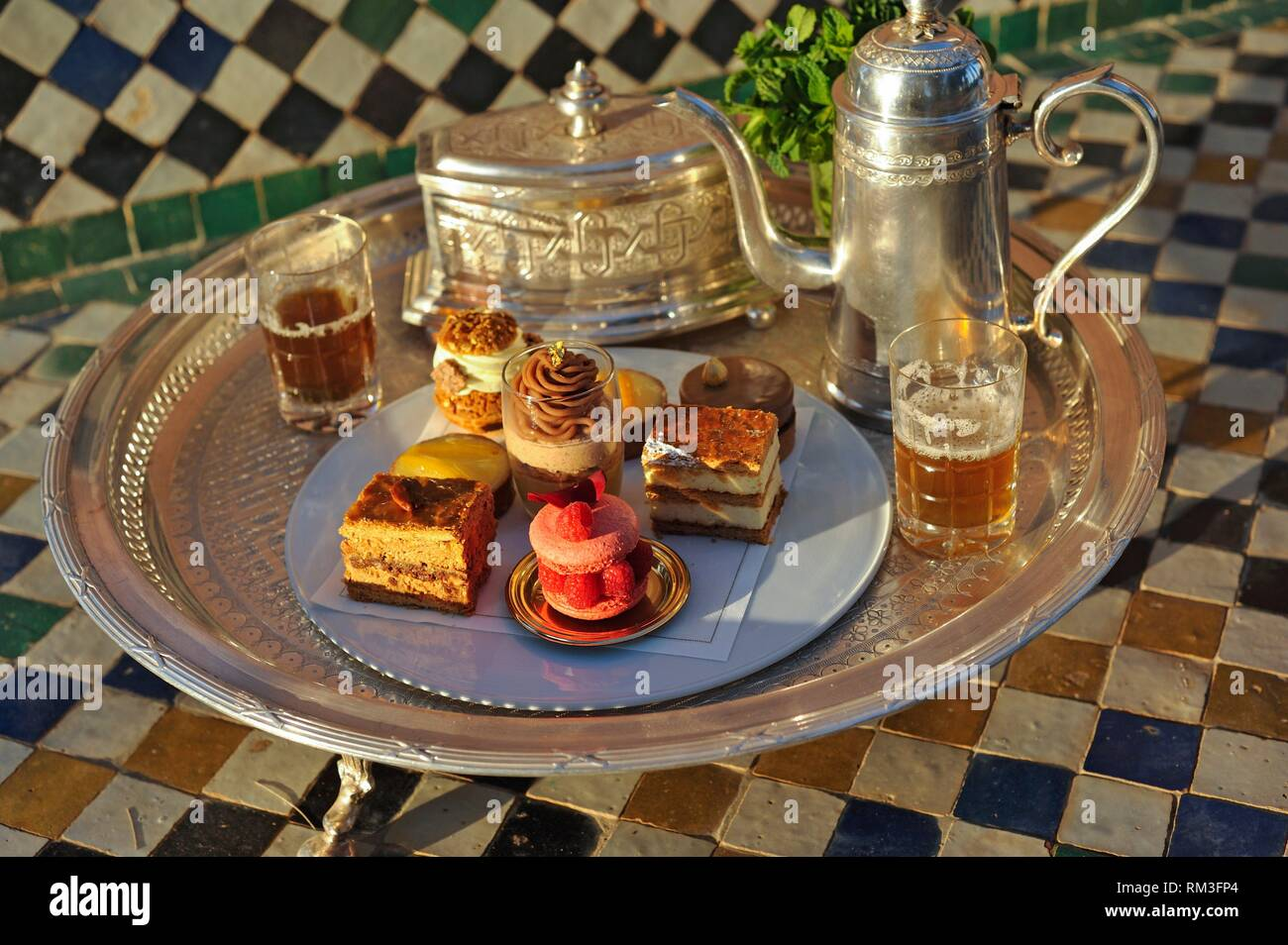 pastries designed by Pierre Herme and made by Richard Bourlon, served with mint tea at the pavillion Menzeh within the gardens of the luxury 5 stars - Stock Image