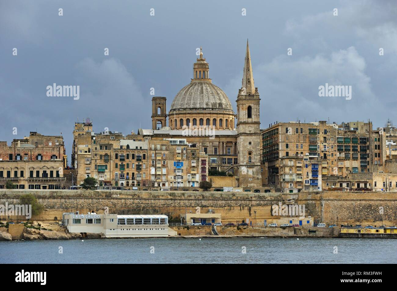 St. Paul´s Anglican Pro-Cathedral and Carmelite Church of Valetta viewed from Sliema, Malta, Mediterranean Sea, Southern Europe. - Stock Image