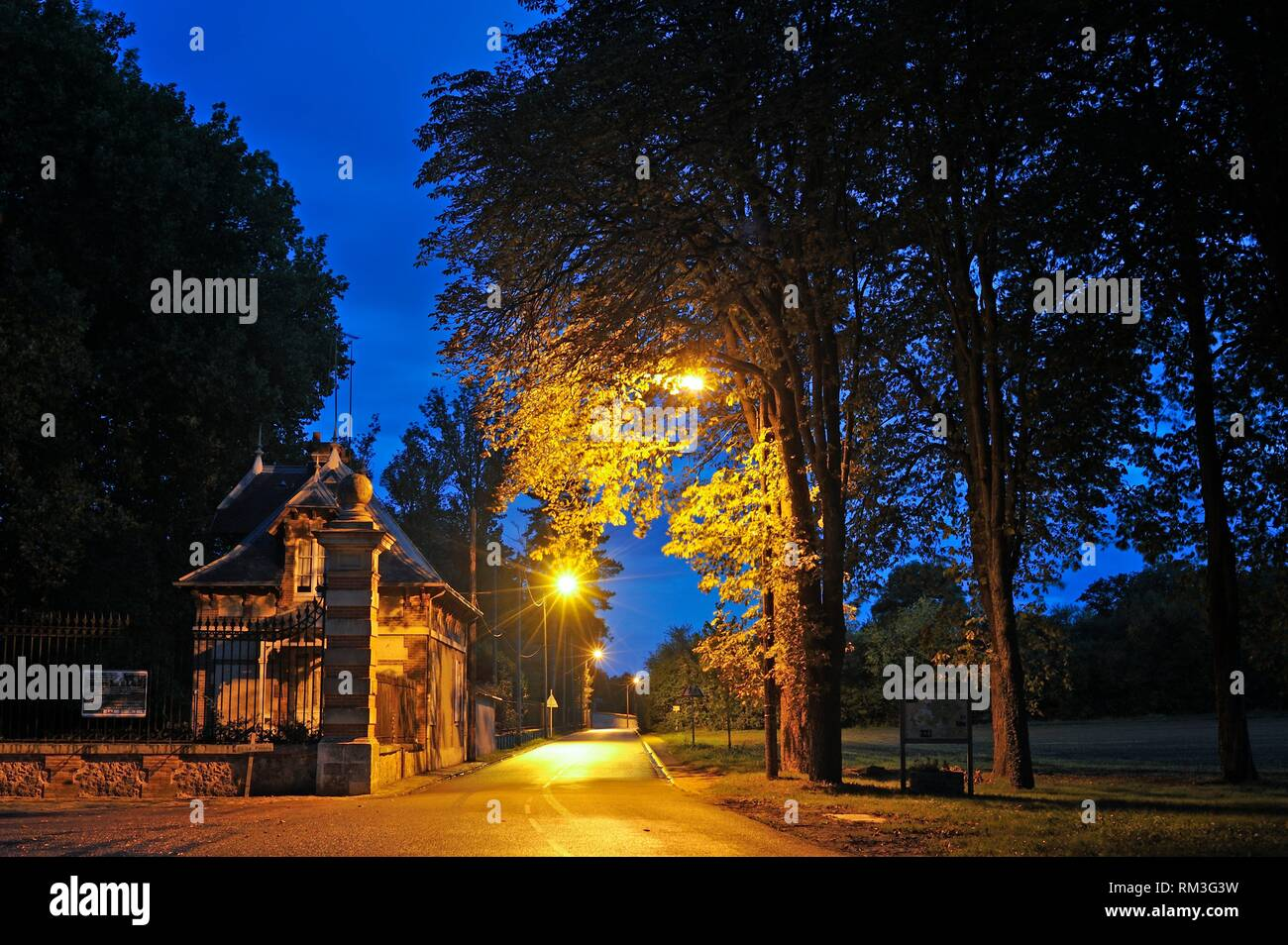 gatehouse of the Chateau de la Boissiere by night, located at the edge of the Forest of Rambouillet, Haute Vallee de Chevreuse Regional Natural Park, - Stock Image